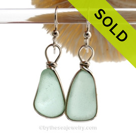 Perfectly matched Aqua Green Blue sea glass pieces from Seaham England are set in our Original Wire Bezel© earring setting.