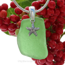 A nice piece of Green Natural Sea Glass Necklace Set On Silver Bail With Black Neoprene Cord with sterling clasps and finished with a solid sterling Starfish Charm.