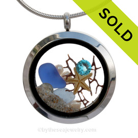 Beautiful dark blue and light blue sea glass combined in a stainless steel locket necklace a real starfish, pearls and beach sand. A seafan makes this a great choice for any ocean lover! SOLD - Sorry this Sea Glass Locket is NO LONGER AVAILABLE!