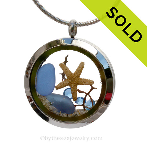 Beautiful Dark Blue Sea Glass combined in a Stainless Steel Locket necklace a real starfish Swarovski crystals in Carolina Blue and beach sand. A great choice for any ocean and beach lover! SOLD - Sorry This Sea Glass Jewelry Item is NO LONGER AVAILABLE!