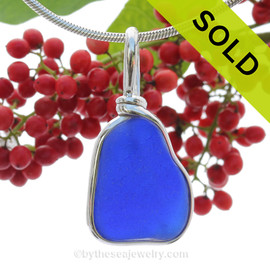 A PERFECT neat shaped naturally aged and Stunning Blue sea glass set in our Original Wire Bezel© necklace pendant. This original signature By The Sea setting encases the glass in silver and leaves both front and back open so you can feel the texture of this antique top quality glass.  This setting also leaves the glass just the way it was found on the beach.