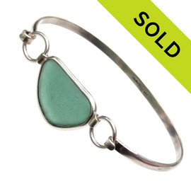 Nice Aqua Green Sea Glass Bangle Bracelet set in our Deluxe Wire Bezel© Solid Sterling Silver. SOLD - Sorry this Sea Glass Jewelry selection is NO LONGER AVAILABLE!