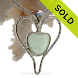 Tell her you love her TWICE as much with this beautiful P-E-R-F-E-C-T and Bright Sea Green Sea Glass Heart set in our Double Love Deluxe Wire Bezel Pendant setting! This piece features the glass and beauty of this Green Sea Glass and is presented on a professionally our Deluxe Wire Bezel Setting© that leaves the sea glass UNALTERED from the way it was found on the beach. An extra heart was created to frame the heart and emphasize the love!