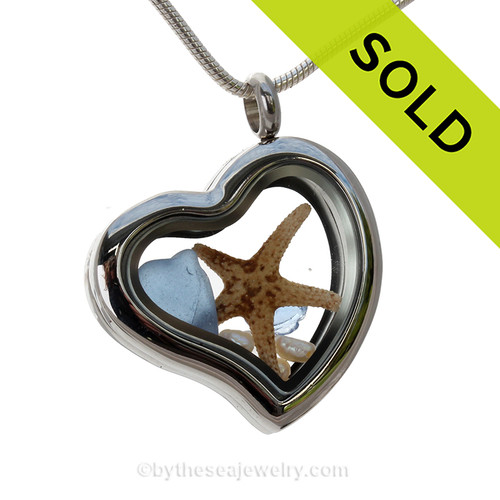 A Beautiful piece of Carolina Blue combined with a real Starfish and Fresh Water Pearls  in this Genuine Sea Glass Heart Locket Necklace.