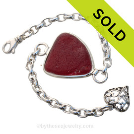 Large Ruby Red Sea Glass set in our Premium Deluxe Wire Bezel© Solid Sterling Silver  ith large hearts charm. This is the EXACT Sea Glass Bangle Bracelet you will receive!