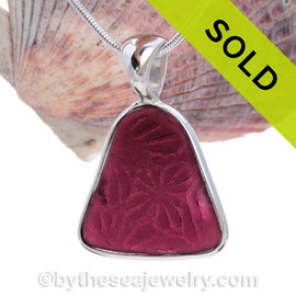 This Huge and Thin Embossed Plum Genuine Sea Glass set in Solid Sterling Silver Deluxe Wire Bezel setting. This setting leaves this amazing natural sea glass piece just the way it was found on  the beach!  This setting leaves this amazing natural sea glass piece just the way it was found on  the beach!