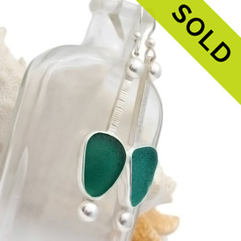 A stunning pair of vivid aqua sea glass earrings set in a finely crafted setting in sterling silver. SOLD - Sorry this Limited Edition Sea Glass Jewelry selection is NO LONGER AVAILABLE!!