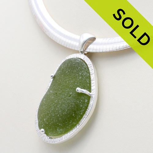 A huge piece of olive green sea glass from England set in a custom made cage. The sea glass is held secure front and back with soldered prongs.  SOLD - Sorry this Sea Glass Necklace is NO LONGER AVAILABLE!