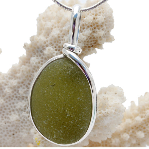 Great piece of natural Seaweed Green Genuine Sea glass in my Original Sterling Silver Wire Bezel© a simple design that lets all the beauty of this glass shine.  Top quality sea glass.