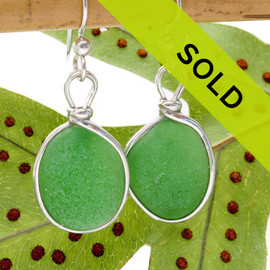 Circular green sea glass pieces UNALTERED from the way they were found on the beach set in our Original Wire Bezel© setting. Sorry this pair has sold!