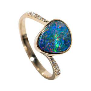 A GIRL'S BEST FRIEND 14KT YELLOW GOLD & DIAMOND AUSTRALIAN OPAL RING