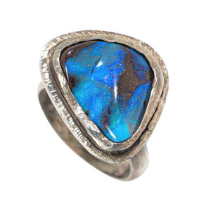 A ROYAL BLUE STERLING SILVER AUSTRALIAN SOLID OPAL RING