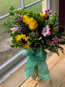 Two deluxe flowers, filler flowers, greenery, deluxe ribbon bow and vase