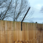 ProtectaPet® Dog Fence Standard Bracket in use.