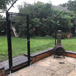 ProtectaPet® Single Gate in use with bolt downs on patio.