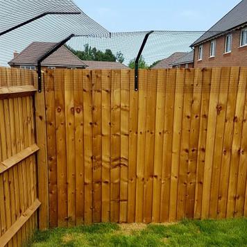 ProtectaPet® Cat Fence Left Corner Bracket in use.