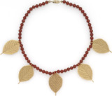 "16"" Carnelian necklace and 5 leaf motif charms - Museum Shop Collection - Museum Company Photo"