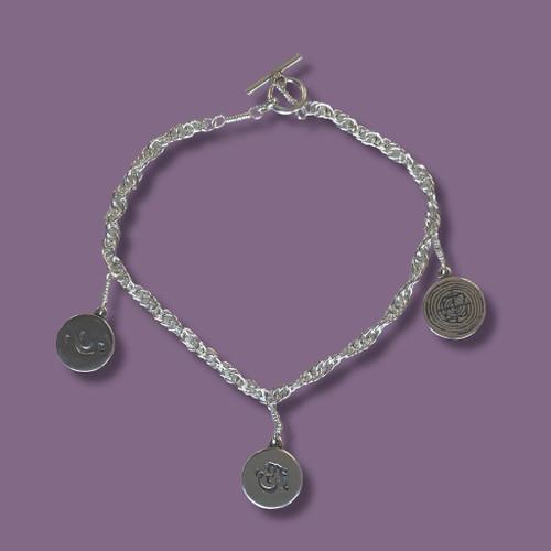 Silk Road Symbols Sterling Silver Bracelet - Inspirational Jewelry Photo