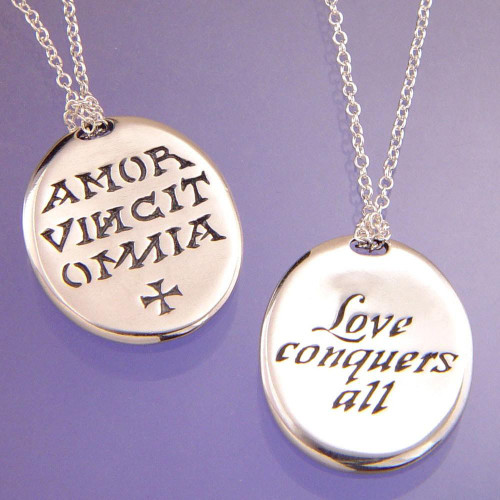 Love Conquers All Sterling Silver Necklace - Inspirational Jewelry Photo