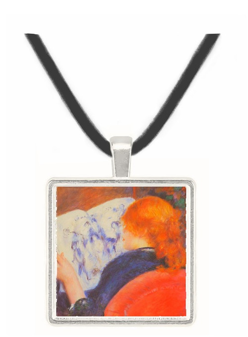 Young woman reads illustrated journal by Renoir -  Museum Exhibit Pendant - Museum Company Photo
