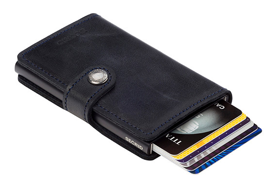 49bf97f2b63 Click Secrid wallet lever and to others amazement, your cards will slide  neatly out of