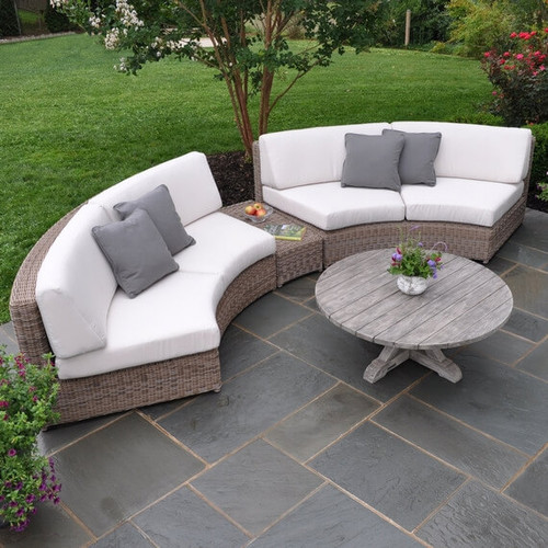Consists of two Sectional Curved Armless Love Seats and one Wedge /Table. Coffee table sold separately.