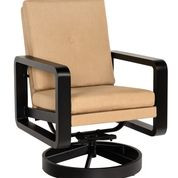 This swivel lounge chair has an upholstered back under a loose back cushion.  Search 7D0477 for the swivel lounge chair with a loose back cushion.