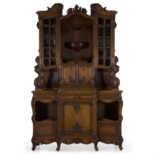 A very finely carved and crafted buffet deux corps from the last quarter of the 19th century, it is English but designed in the taste of the French with the heavy influence of Rococoism.