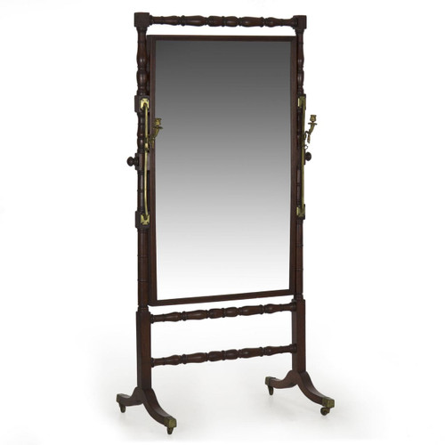 A large and striking cheval mirror from the Regency period, this attractive piece is such an interesting design element with original cast brass hardware and candle sconces and angular form.