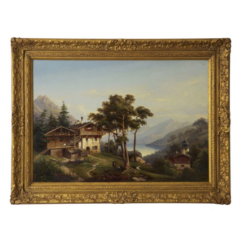 An exceptional genre scene of a German landscape under a nearly cloudless sky, a large wood and stone chalet is tucked into a grove of pine trees overlooking the blue lake below.