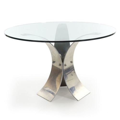 An angular modern center table with a thick glass top raised over three symmetrical angular tapered panels of curved aluminum, these each locked firmly together with oversized bolts through a central triangle.