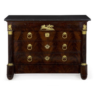 A lovely Empire commode with an Egyptian black marble top, it features the most attractive display of flamed mahogany veneer matching throughout the drawers.