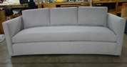 Custom curved sofa with track arm