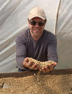 Len with green coffee benas in Costa Rica