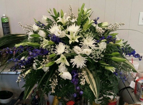 Blue and White Spray of Lilies, White Fuji Mums, Delphinum, Roses, and Assorted Greenery.