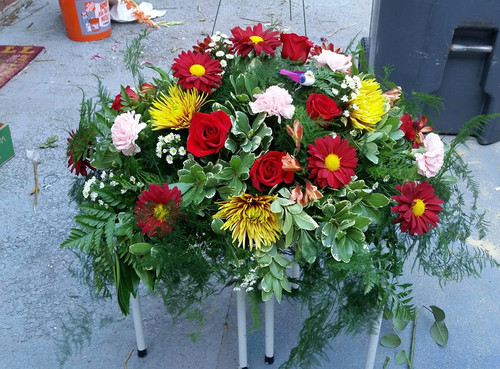 Designers Choice Casket Spray, Multitude of Colors and Flowers in many colors. Flowers could consist of Lilies, Roses, Mums, Sunflowers, Daisies, Carnations. Will always have at least 6 types of flowers.