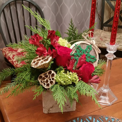 The Bloom Closet's Simply Christmas. A mix of roses, mums and lotus pods with keepsake rustic ornament in birch covered tin vase.