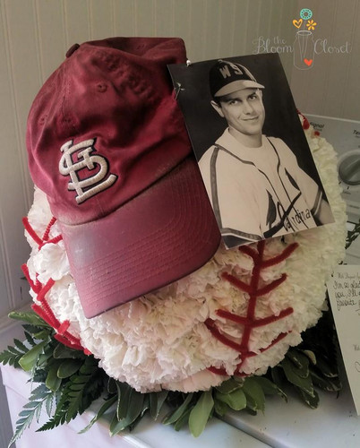 Baseball Flower Tribute with players cap and photo is optional.