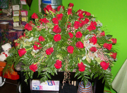 3 dozen Red Roses Casket Spray with Accent Greenery