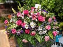 The Bloom Closet Stargazer and Roses Casket Spray