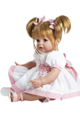 """Size: 20""""  • Sandy Blond Hair/Blue Eyes • Hand-painted faces • Hand applied eyelashes • Hand-sewn premium quality fashions • Weighted bodies made to feel just like a real baby • Fresh baby powder scent • For ages 6+   Come join the party! This birthday baby is just a doll in her precious white eyelet dress with all the pink frills. Fancy appliquéd balloons and a cupcake with a yellow candle decorate the front. Pink streamers cascade from a neat polka-dot bow at the waist. From her polka dot bow-tied sandy blond pigtails, to her pink scalloped sandals she is a lovable gift all wrapped up in birthday magic. Make a wish!   Perfect for ages 6 and above."""