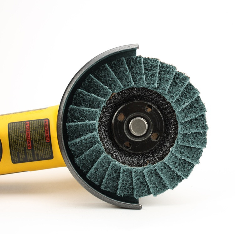 Angle grinder with blue surface conditioning flap disc