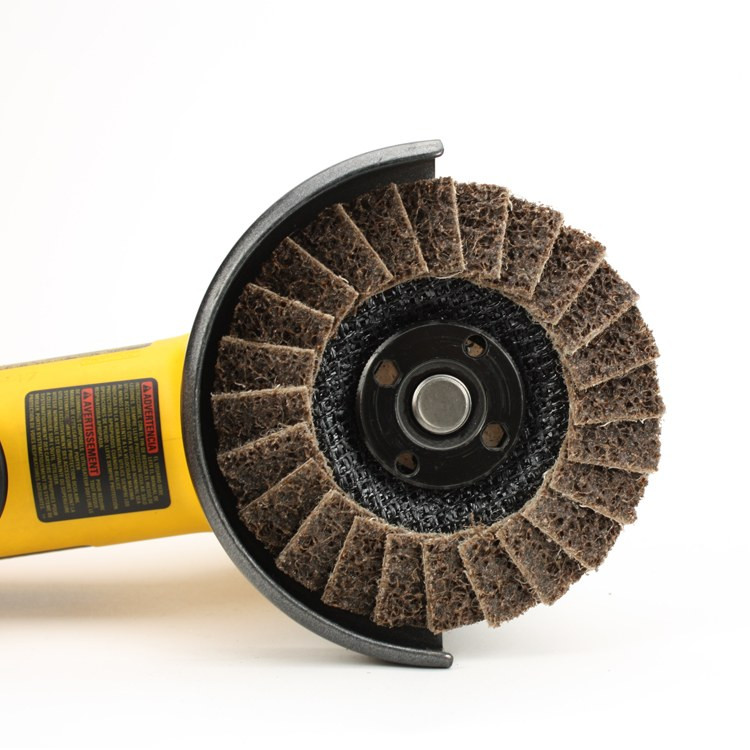 Angle grinder with brown surface conditioning flap disc