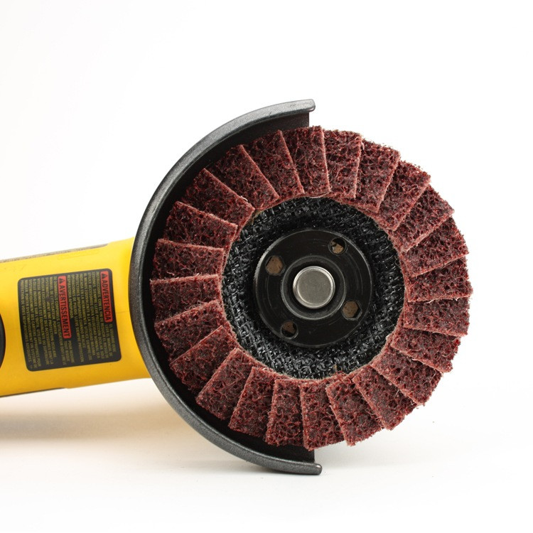 Angle grinder with red surface conditioning flap disc