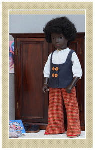 """The fabric as it was pictured in the Fall 2014 issue of Doll News.  The Sasha doll shown is 16"""" tall."""