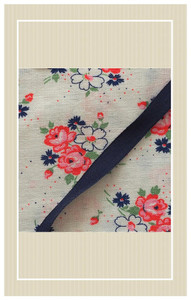 Pretty floral feedsack with matching navy ribbon