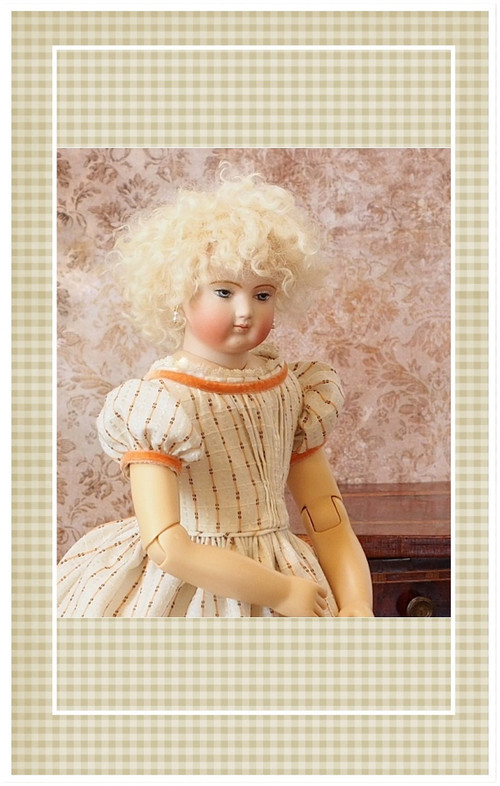 This lovely enfantine style dress is suitable for a doll of the 1852-1872 time period.