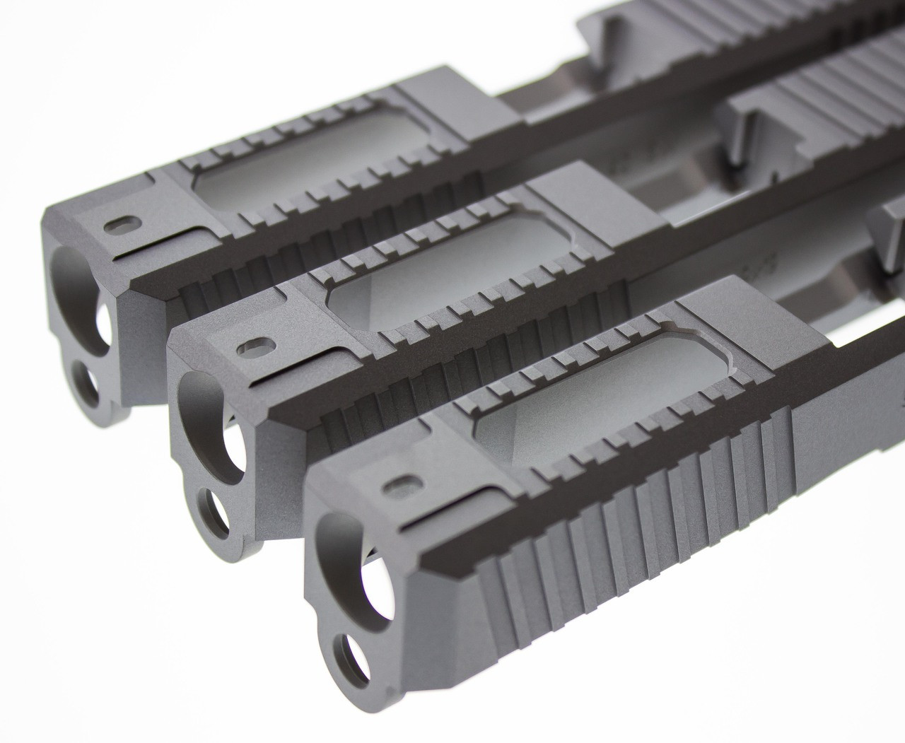 Ported Gripper Slide Cut Machining for Glock Slide by Battle Werx, Glock Front Slide Serrations, Enhanced Glock Rear Slide Serrations, 45 degree corner chamfers. Top Glock slide serrations, Top slide port.