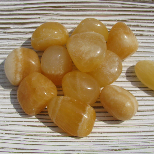 Medium Tumbled Orange Calcite Stones