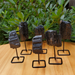 Rough Black Tourmaline Pieces on a Metal Pin Stand, Group Picture